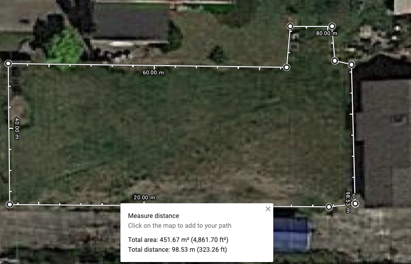satellite image from Google Maps showing a lawn with measurements around it